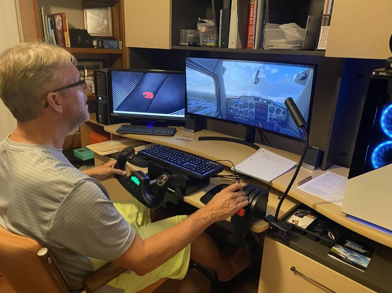 Older man at his computer playing Microsoft Flight Simulator
